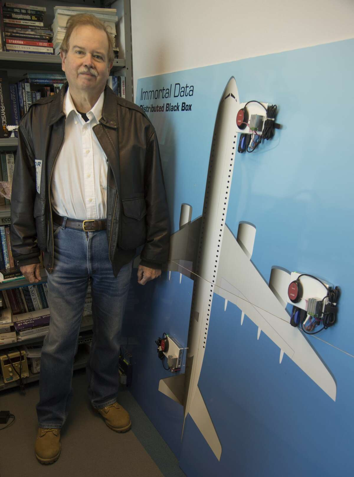 Dale Amon, president of Immortal Data, shows his patented multiple aircraft black box design in his office on Feb. 10.