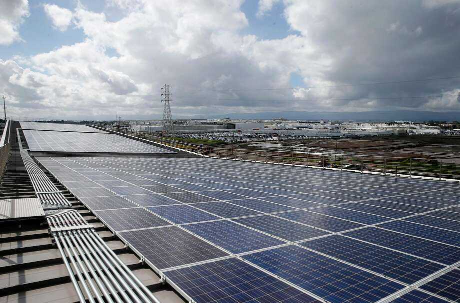 A solar panel array collects energy from the sun across the roof of the Warm Springs BART station in Fremont. Most of the 260,000 Americans employed in the solar industry sell or install panels — and as solar cell prices plunged about 60 percent during the last five years, business has boomed. Photo: Paul Chinn, The Chronicle