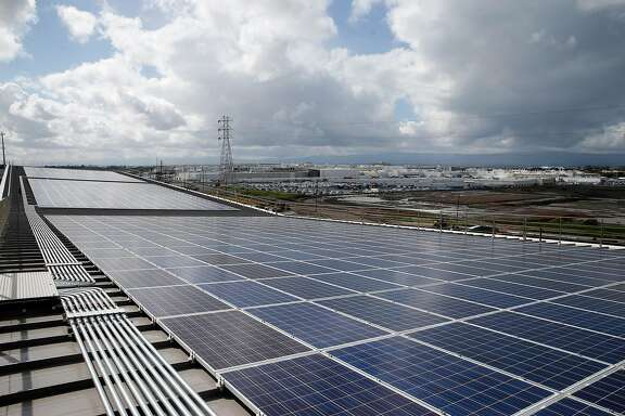 A solar panel array collects energy from the sun across the roof of the Warm Springs BART station in Fremont, Calif. on Wednesday, March 22, 2017. The new station in south Fremont opened for revenue service on Saturday after years of delays.