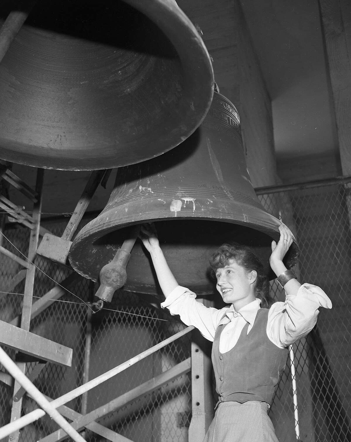 Bells of the Hoover Institution Tower on the Stanford University Carillon player Olwen Wymark looks at bells Photos shot November 3, 1953