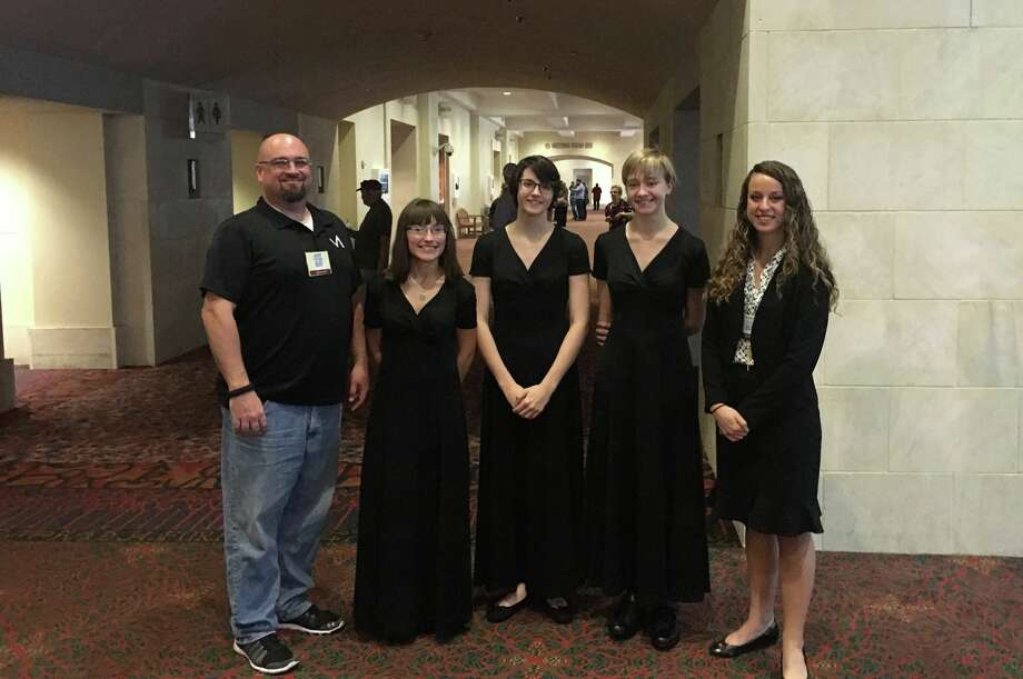 Magnolia High School Band Director John Winebrenner, MHS senior Carol Pettijohn, MHS senior Dawn McKamie, MHS sophomore Devin Stone and MHS Assistant Director Kirby Goode at the TMEA All-State Convention. Photo: Kelly Schafler