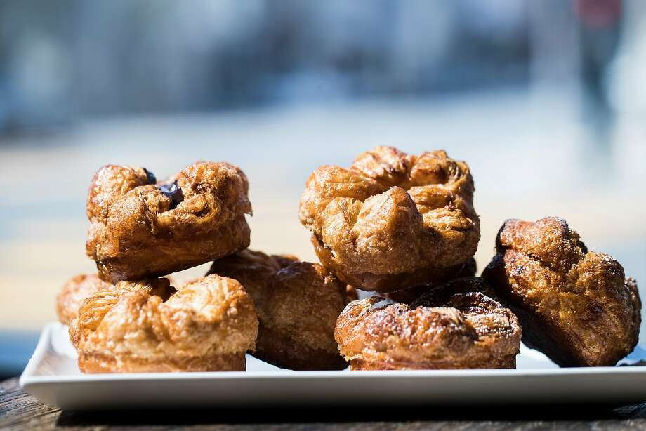 Click through this slideshow to see the things everyone has to do at least once in the Bay Area, including eating a (pictured) Kouign Amann from B Patisserie SF. Photo: Stephen Lam, Special To The Chronicle