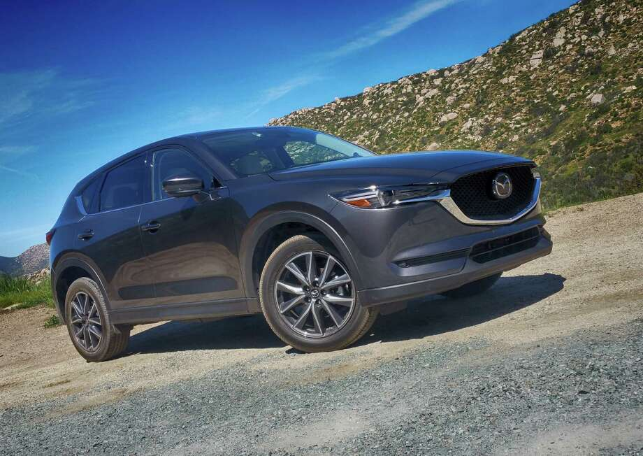Landing in showrooms in the next week or two, Mazda's all-new 2017 CX-5 crossover comes with standard LED headlights, back-up camera and 17- or 19-inch alloy wheels. Photo: Jeff Yip