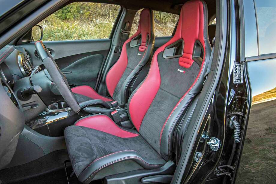 Nismo RS comes with Recaro front bucket seats with red leather side bolsters and black suede center inserts. These heavily bolstered seats are designed to help hold the driver and front passenger in place during spirited driving. They also have embossed Recaro and stitched Nismo logos, as well as red stitching. Photo: Nissan North America / © 2016 Nissan