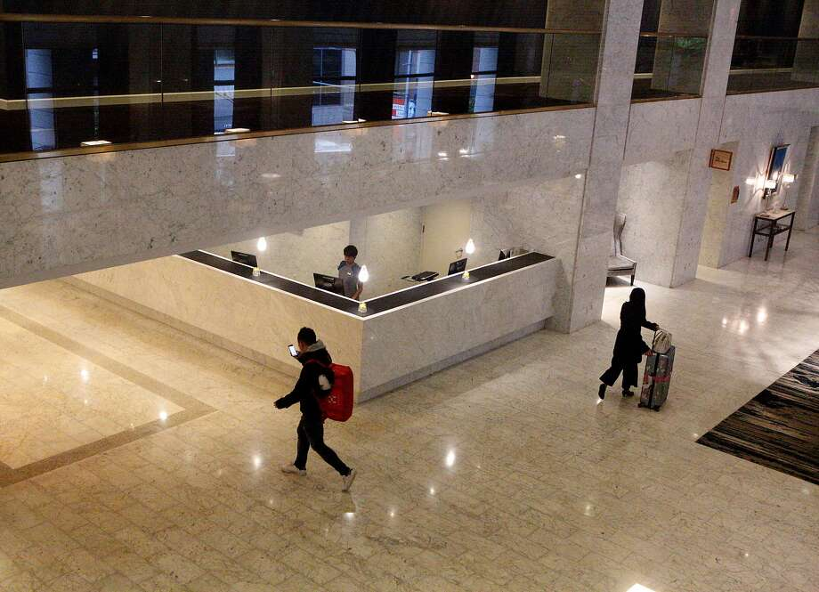 Guests walk through the lobby in Hotel Nikko in San Francisco. San Francisco has seen growth in the hotel tax. Photo: Natasha Dangond, The Chronicle