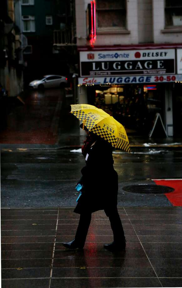 People walk through the rain in downtown San Francisco on Friday, March 24, 2017, in San Francisco, Calif. Photo: Natasha Dangond, The Chronicle