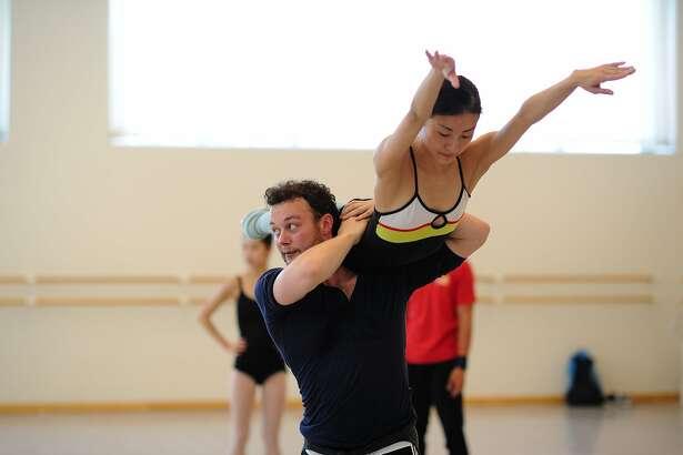 "CAPTION: Liam Scarlett rehearses Yuan Yuan Tan in his San Francisco Ballet commission, ""Fearful Symmetries."" opening Jan, 27. Photo by Erik Tomasson Yuan Yuan Tan and Liam Scarlett rehearse Scarlett's Fearful Symmetries. (� Erik Tomasson)"