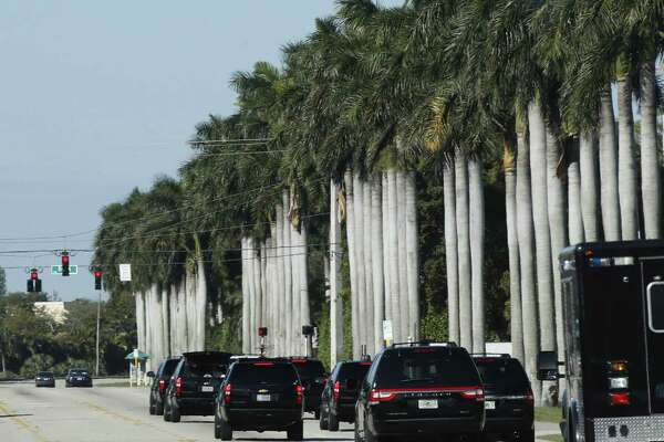 President Donald Trump's motorcade drives in West Palm Beach, Fla., Saturday, March 18, 2017, toward the Trump International Golf Club. (AP Photo/Manuel Balce Ceneta)