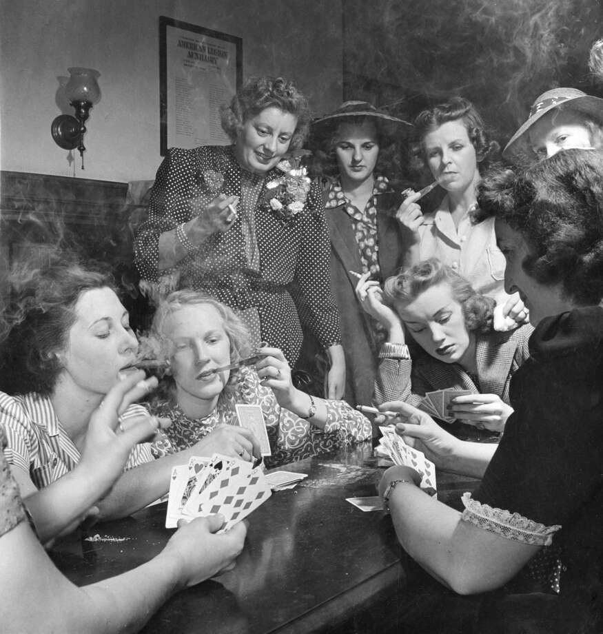 Members of the Young Women's Republican Club (YWRC) smoke and play cards, Milford, Connecticut, May 20, 1941. To see what life was like in 1941, before and after the attack on Pearl Harbor, check out the gallery above.  Photo: Nina Leen/The LIFE Picture Collection/Getty Images