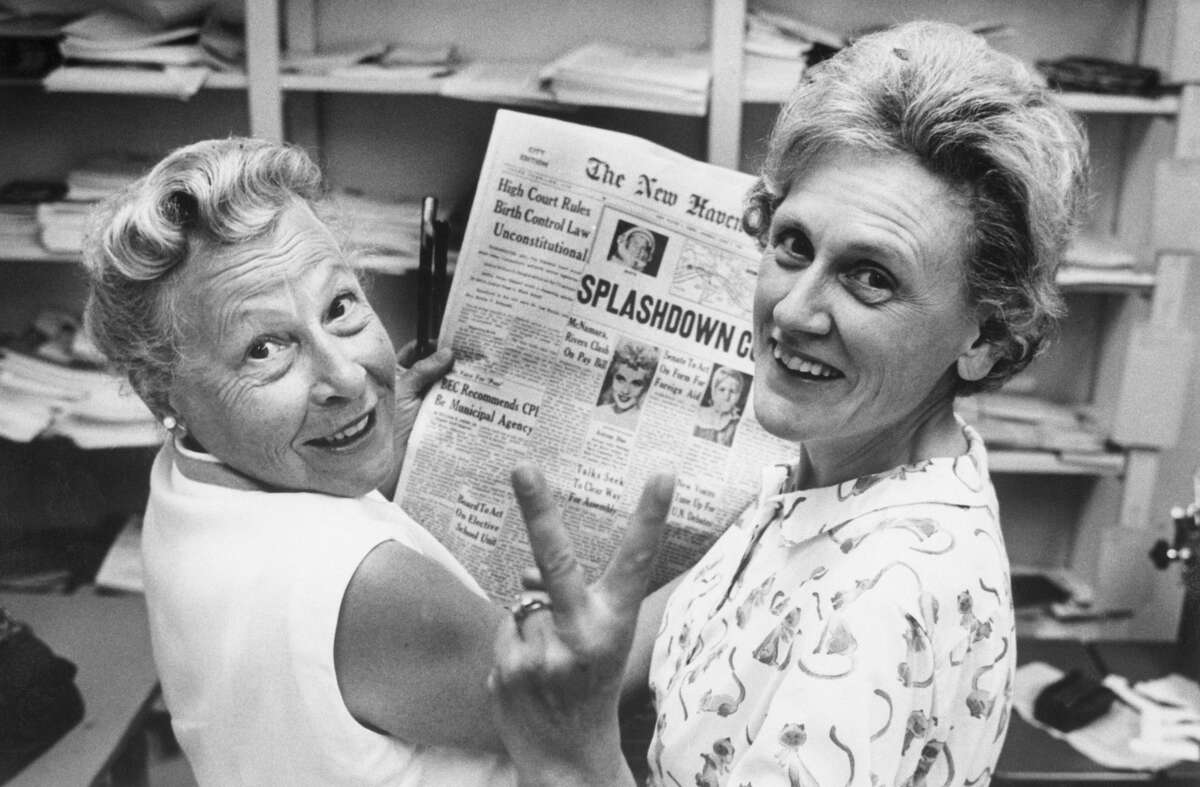 Mrs. Estelle Griswold (L), medical advisor and Executive director of the Planned Parenthood Clinic in New Haven, and Mrs. Ernest Jahncke, President of Parenthood League of Connecticut, INC., flash a victory sign as a result of the court's decision that the birth control law is unconstitutional.