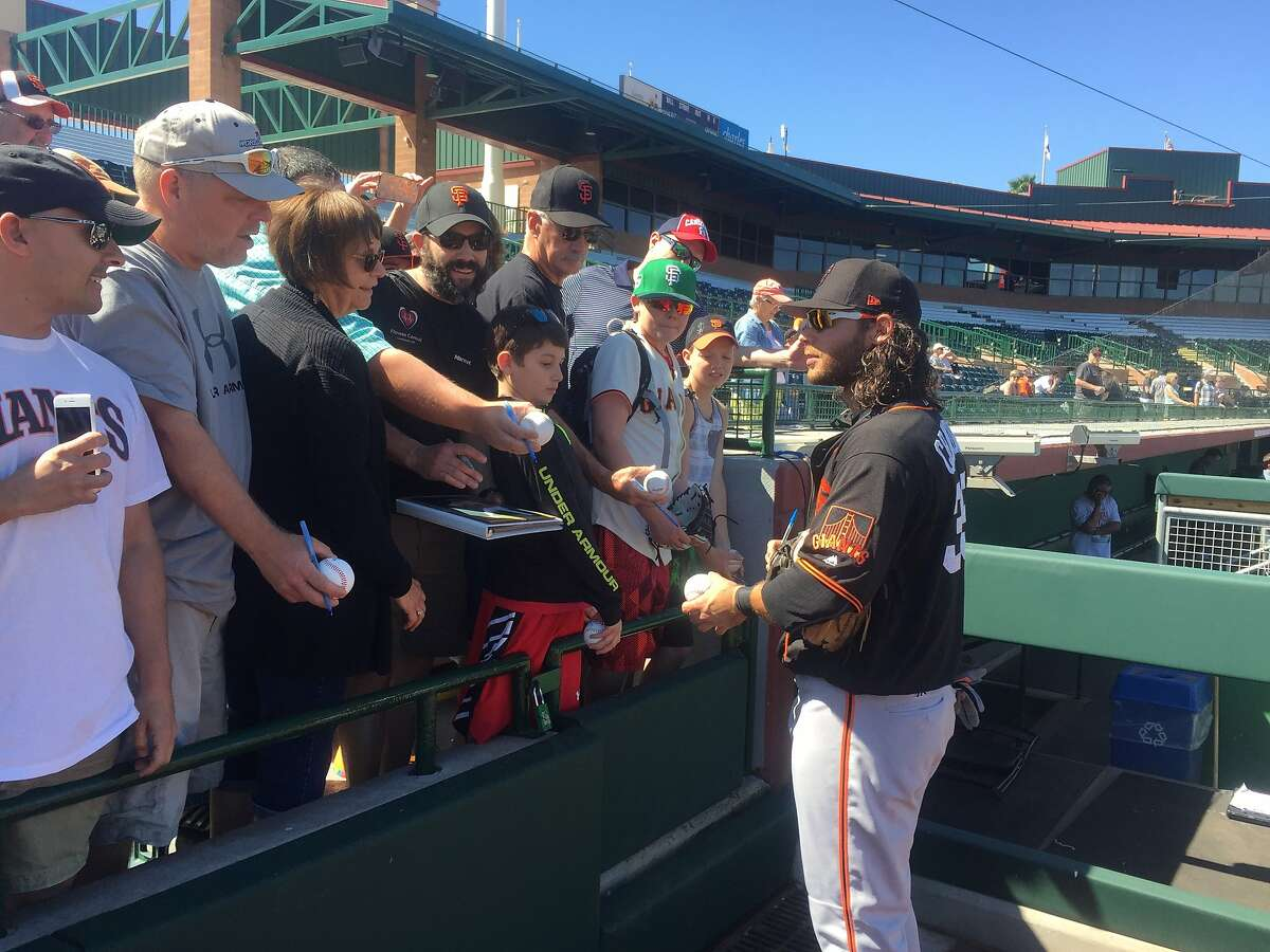 Brandon Crawford signs autographs after a 2017 batting practice session at Scottsdale Stadium.