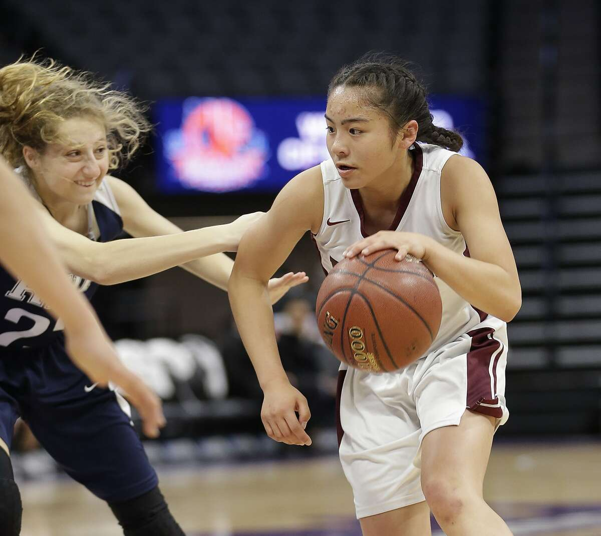 Eastside College Prep's Zion Gabriel, right, drives against Rolling Hills Prep's Natalie Valvo during first half of the girls CIF Division V high school basketball championship game, Friday, March 24, 2017, in Sacramento, Calif. Eastside College Prep won 63-40. (AP Photo/Rich Pedroncelli)