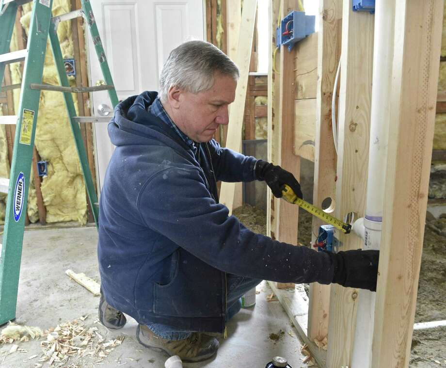 Jim Caruso, from Caruso Plumbing, is making a bathroom ADA compliant in one of the units of Reynolds Ridge, in Bethel. Community Development Block Grants, a program President Trump wants to cut in his budget, are being used to upgrade Reynolds Ridge, an affordable housing community in Bethel, Conn. Friday, March 24, 2017. Photo: H John Voorhees III / Hearst Connecticut Media / The News-Times