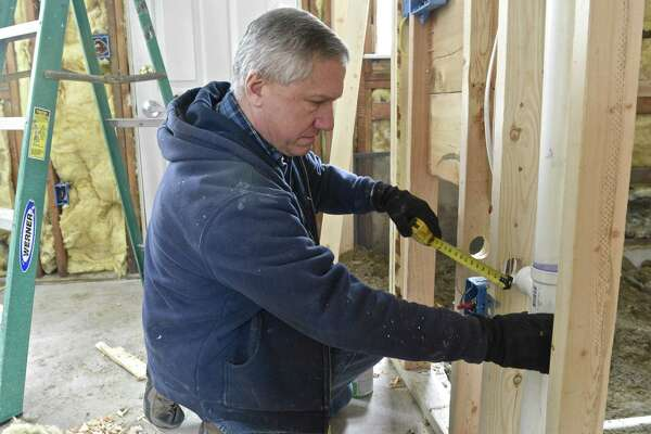 Jim Caruso, from Caruso Plumbing, is making a bathroom ADA compliant in one of the units of Reynolds Ridge, in Bethel. Community Development Block Grants, a program President Trump wants to cut in his budget, are being used to upgrade Reynolds Ridge, an affordable housing community in Bethel, Conn. Friday, March 24, 2017.