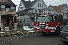 Bridgeport fire crews investigating the cause of a fire at 173 Whitney Ave that left 10 people displaced Friday afternoon