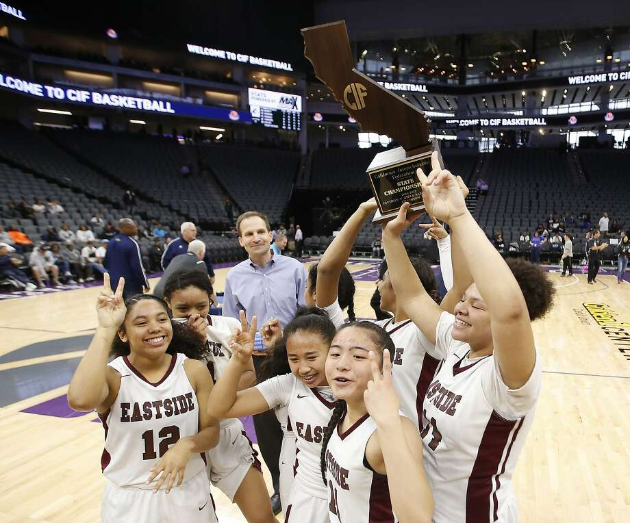 Eastside Prep players celebrate after beating Rolling Hills, 63-40, for the girls state Division 5 basketball championship at Golden 1 Center in Sacramento. Photo: Rich Pedroncelli, Associated Press