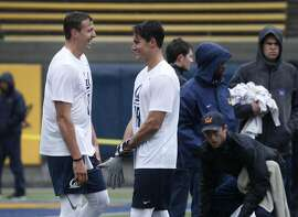 Quarterback Davis Webb (left) and wide receiver Chad Hansen smile before a passing drill during the Pro Day workout for graduating Cal Bears players in front of NFL scouts and coaches in Memorial Stadium at UC Berkeley on Friday, March 24, 2017.