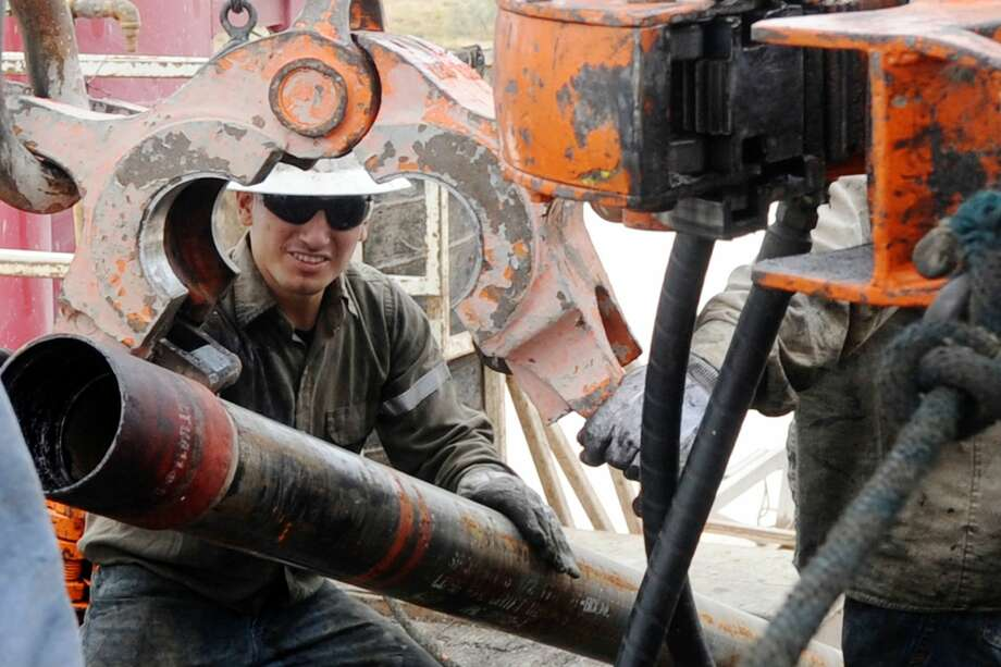 Noe Olvera loads maneuvers a section of casing to be put downhole on Trinidad Rig 433 on Nov. 2, 2016, in Midland County. Photo: James Durbin/Reporter-Telegram