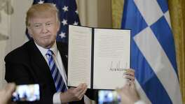 U.S. President Donald Trump holds the Greek Proclamation after signing it during an event to celebrate Greek Independence Day in the East Room the White House on March 24, 2017 in Washington, D.C. (Olivier Douliery/Abaca Press/TNS)