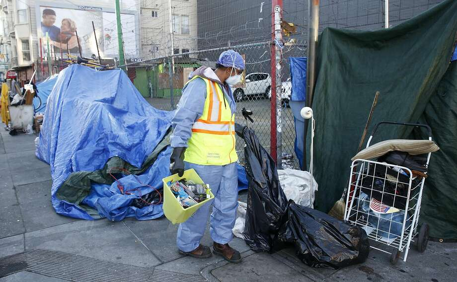 A homeless encampment at 14th and Mission streets in the Mission District is taken down so a San Francisco Public Works crew can disinfect the sidewalk. Photo: Paul Chinn, The Chronicle