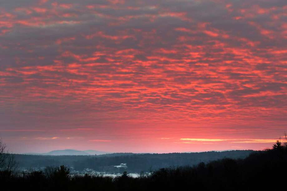 The spring sun rises above Saratoga Lake and casts a wide tapestry of color early Tuesday March 21, 2017 in Malta, N.Y. (Skip Dickstein/Times Union) Photo: SKIP DICKSTEIN, Albany Times Union