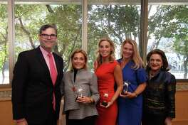 Ed Wolff and Beth Wolff, right, congratulate Linda Ricca, Kim Hohman and Cindy Cook, winners of the Rising Star Awards.