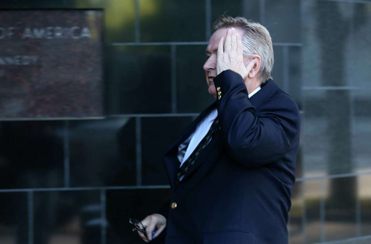 Steve Stockman covers his face while entering the United States District Courthouse Tuesday, March 21, 2017, in Houston.