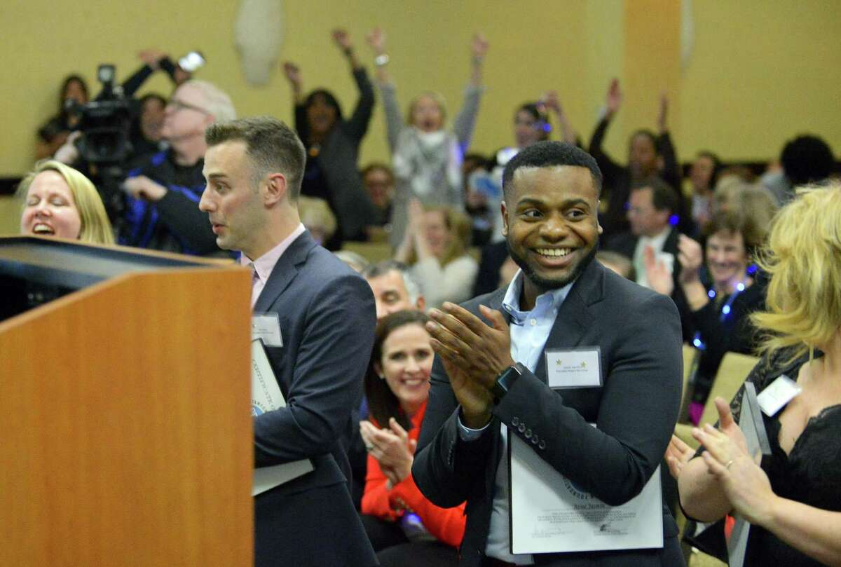 Family and friends celebrate as Josue Jasmin of Rogers International School is named as co-Educator Award winner, along with Claude Morest of AITE during the Stamford Public Education Foundation 2017 Excellence in Education Awards ceremony at the Sheraton Stamford Hotel in Stamford, Conn. on March 23, 2017.