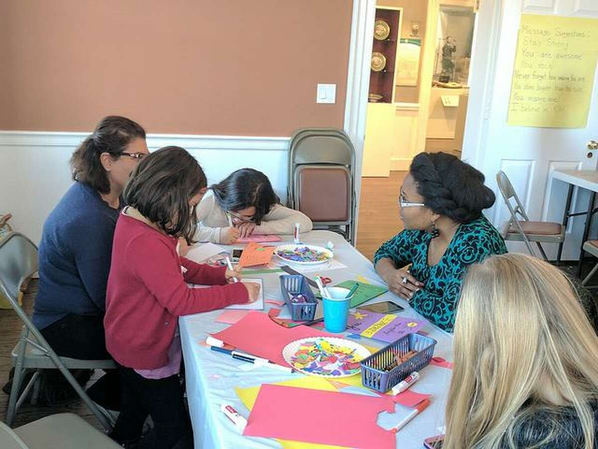 Adults and children from all over Fairfield County gathered at the Norwalk Historical Society Museum on Sunday, Jan. 15, 2017 to further Dr. Martin Luther King Jr's message of peace and love by creating uplifting cards for the nonprofit, Cards for Hospitalized Kids. The society mailed over 100 cards to the organization which will distribute them to hospitals and Ronald McDonald Houses across the country.