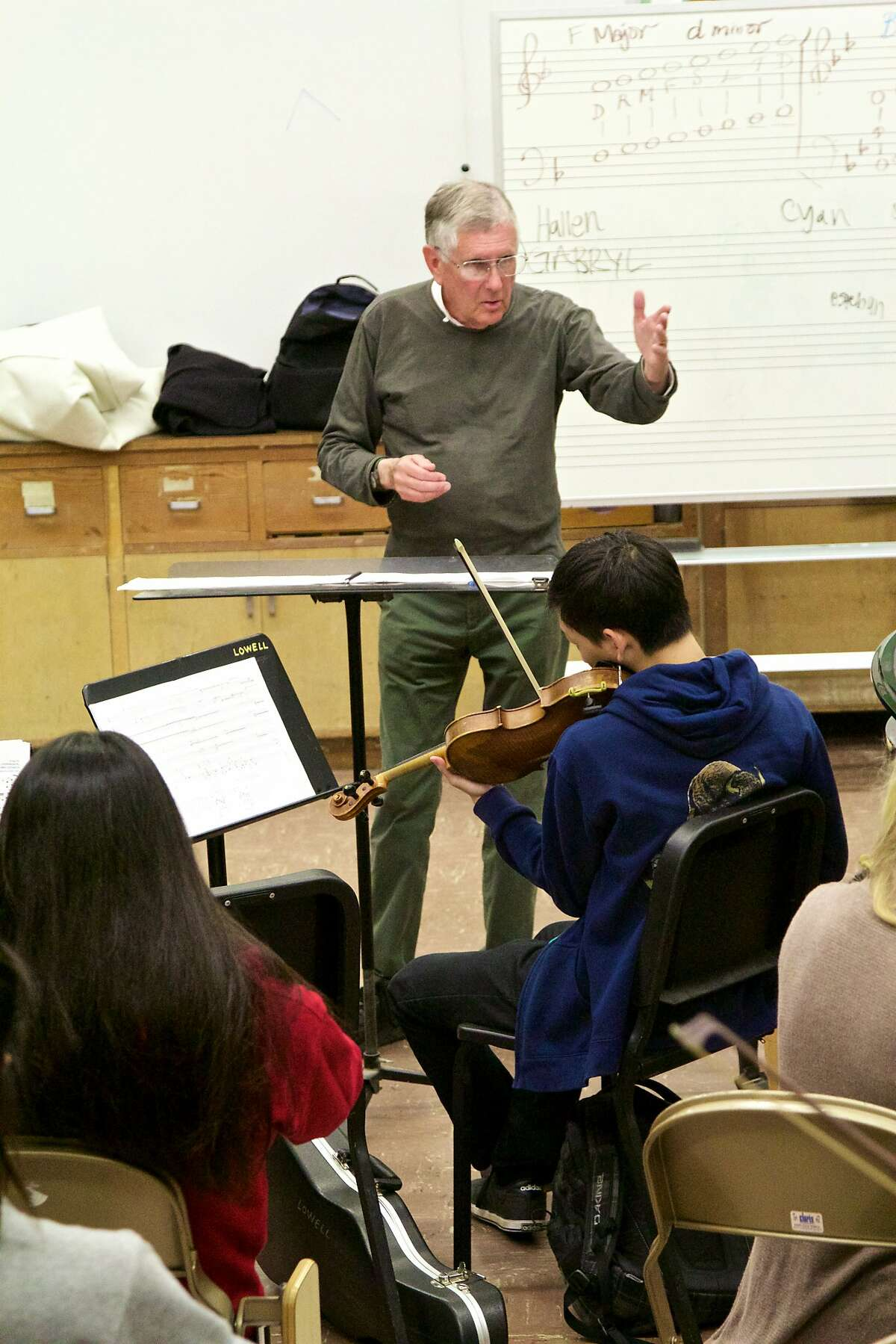 San Francisco composer Charles Boone rehearses his new commissioned piece with the Lowell High School string orchestra in advance of it premiere April 6.