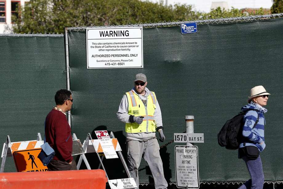 A condominium construction site at 1598 Bay St. in the Marina displays a sign warning of hazardous material. Photo: Paul Chinn, The Chronicle