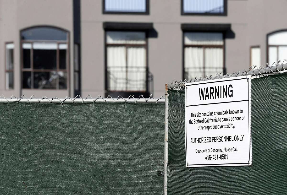 A condominium construction site at 1598 Bay Street displays a sign warning of hazardous material in the Marina District of San Francisco, Calif. on Thursday, March 23, 2017. PG&E has been quietly buying property on land the utility operated manufactured gas plants long ago which is still contaminated. PG&E excavated the hazardous soil, replaced it with clean dirt and resold the land.