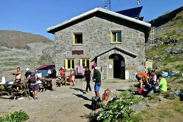 Guests at the Refugio de Góriz in the Ordesa and Monte Perdido National Park lather on sunscreen and get ready to head out for the day.