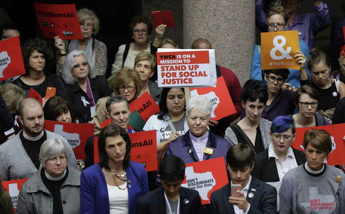 Members of the transgender community and others who oppose Senate Bill 6 protest in the exterior rotunda at the Texas Capitol as the Senate State Affairs Committee holds hearings on the bill, Tuesday, March 7, 2017, in Austin, Texas. The transgender