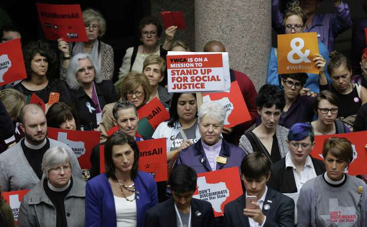 "Members of the transgender community and others who oppose Senate Bill 6 protest in the exterior rotunda at the Texas Capitol as the Senate State Affairs Committee holds hearings on the bill, Tuesday, March 7, 2017, in Austin, Texas. The transgender ""bathroom bill"" would require people to use public bathrooms and restrooms that correspond with the sex on their birth certificate. (AP Photo/Eric Gay)"
