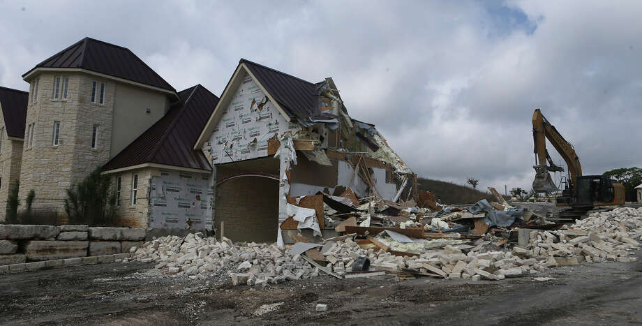 Demolition of the guard house of the former Lerin Hills subdivision on Highway 46 near Boerne is underway Friday March 24, 2017. The structure is to be demolished by Putnam Bridge Funding LLC , which took over the stalled development in 2015 and has rebranded it as Miralomas. Photo: John Davenport, San Antonio Express-News / ©San Antonio Express-News/John Davenport
