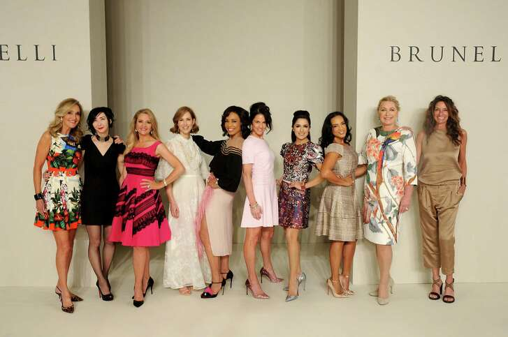 Honorees Jana Arnoldy, from left, Carrie Brandsberg-Dahl, Mary D'Andrea, Carolyn Dorros, Gina Gaston Elie, Jessica Rossman, Sneha Merchant, CleRenda McGrady, Carol Linn and Lisa Holthouse at the 35th annual Houston Chronicle Best Dressed Luncheon and Neiman Marcus Fashion Show
