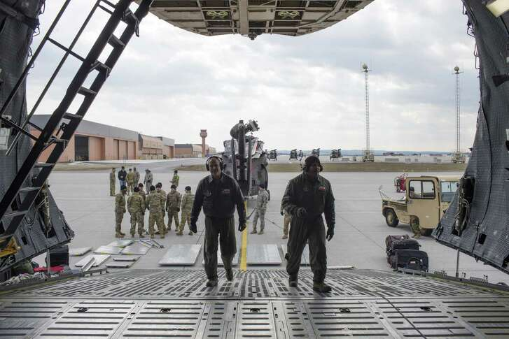 Air Force Reserve's Tech Sgt. Bryan Stone, left, and loadmaster Master Sgt. Eric Mungia prepare the cargo area a C-5M Super Galaxy at Fort Drum, New York, Monday, Feb. 27, 2017. The crew, with the 433rd Airlift Wing, known as the Alamo Wing, was tasked with transporting U.S. Army UH-60 Blackhawk helicopters and soldiers from the U.S. Army 10th Combat Aviation Brigade to Riga, Latvia in support of Operation Atlantic Resolve.