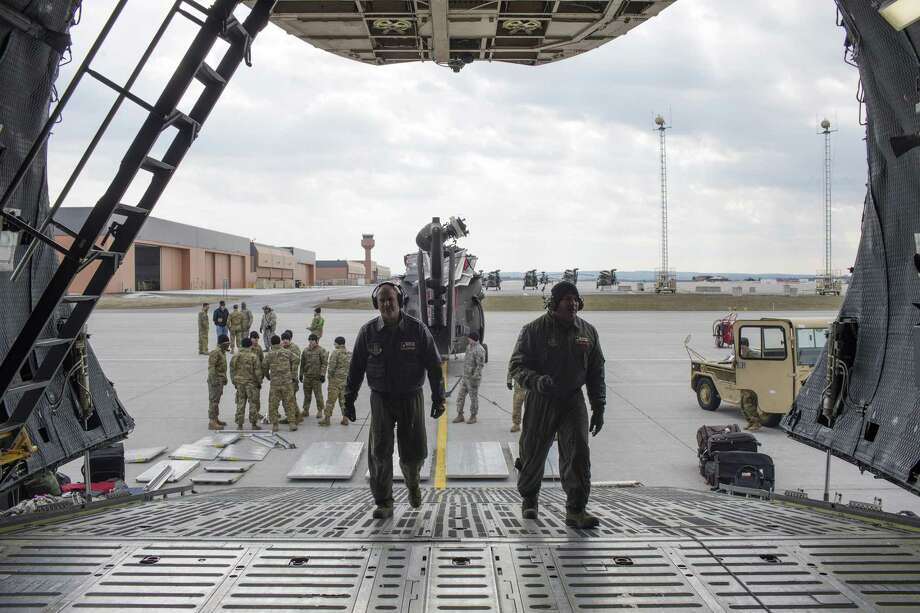 Air Force Reserve's Tech Sgt. Bryan Stone, left, and loadmaster Master Sgt. Eric Mungia prepare the cargo area a C-5M Super Galaxy at Fort Drum, New York, Monday, Feb. 27, 2017. The crew, with the 433rd Airlift Wing, known as the Alamo Wing, was tasked with transporting U.S. Army UH-60 Blackhawk helicopters and soldiers from the U.S. Army 10th Combat Aviation Brigade to Riga, Latvia in support of Operation Atlantic Resolve. Photo: JERRY LARA, Staff / San Antonio Express-News / © 2017 San Antonio Express-News