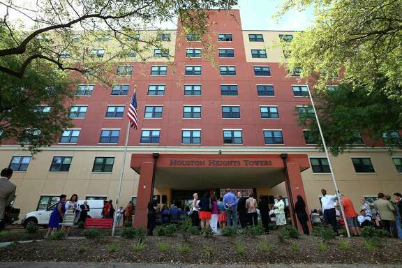 People gathered for the rededication ceremony at the front entrance of the Houston Heights Towers Thursday, March 23, 2017, in Houston. The 223-unit mid-rise residence serves low-to-moderate-income senior adults has been renovated with funding from the City of Houston Housing an d Community Development Department and the Community Bank of Texas. ( Godofredo A. Vasquez / Houston Chronicle )