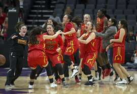 Rosary Academy players celebrate their 62-45 victory over Campolindo in their CIF Girls Division III high school state championship basketball game on Friday, March 24, 2017 in Sacramento, Calif.