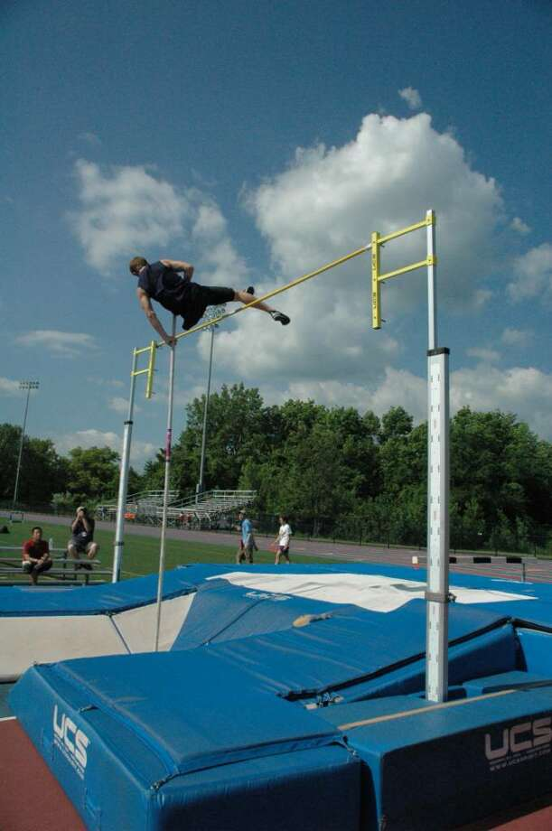 Staples senior Casey Colasurdo finished eighth in the pole vault at FCIACs on May 25. Photo: Mesh, Contributed Photo / Staplesrunning.com / staplesrunning