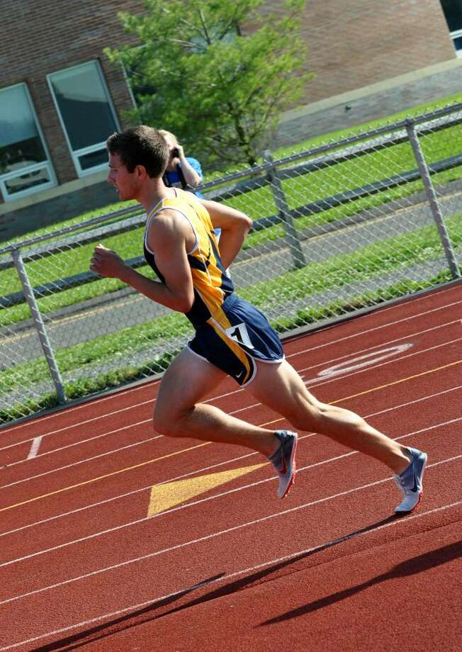 Weston's Steven Piscatelli takes the lead in the 1600 during the SWC boys track championship at Weston on Tuesday, May 25, 2010. Photo: Amy Mortensen / Connecticut Post Freelance