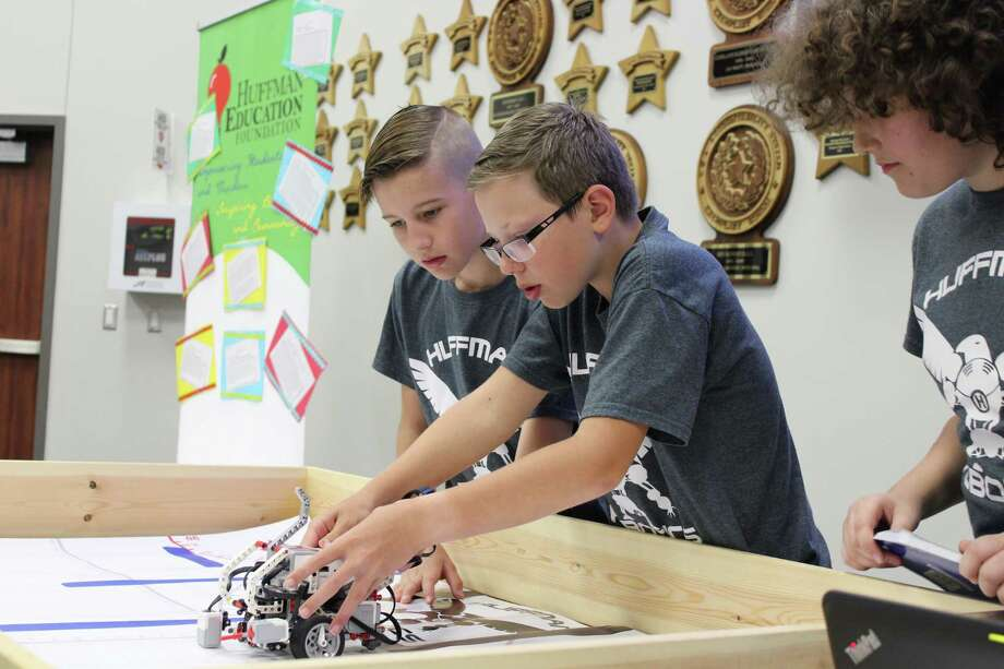 Tucker Pike, Dylan Leps and Konstantin Savvon, pictured from left to right, are fifth-grade students at Copeland Elementary involved in the Robotics Club, which got its start with a grant from the Huffman Education Foundation. Photo: Julie Silva