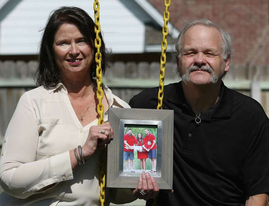 Janis and Matt Stewart hold a frame of the family of her daughter, Sunday Stewart Rowan, on a swing set in their backyard Friday, March 3, 2017, in College Station. Rowan and her husband Matt Rowan, right in the photo, died in the hot air balloon crash in Lockhart in 2016, and left behind a son, Jett Sunday Jones. On the left in the photo is Jett's father, Brent Jones. Photo: Yi-Chin Lee, Houston Chronicle / © 2017 Houston Chronicle