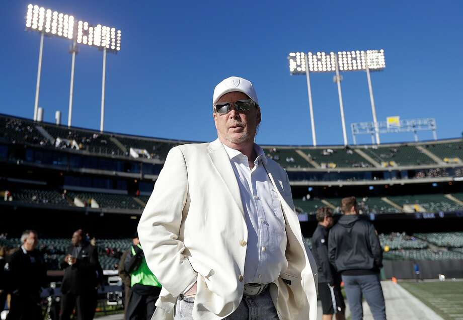 FILE - In this Dec. 24, 2016, file photo, Oakland Raiders owner Mark Davis waits for the team's NFL football game against the Indianapolis Colts in Oakland, Calif. The Raiders' new stadium in Las Vegas  could literally be walking distance from a few of the city�s dozens of sports books. The bottom-line explanation for this move speaks as much about priorities in Vegas as in the NFL: It�s about cold, hard cash. The new stadium will be funded by $750 million from the county, another $650 million from either billionaire Sheldon Adelson or another investor and the remaining $500 million from the Raiders and the league. (AP Photo/Marcio Jose Sanchez, File) Photo: Marcio Jose Sanchez / Associated Press