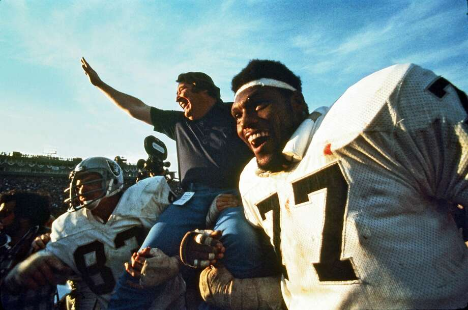 Ted Hendricks (83) and Charles Philyaw give head coach John Madden a lift after the Raiders beat the Vikings in the Super Bowl in 1977. Photo: Dennis Desprois, NFL
