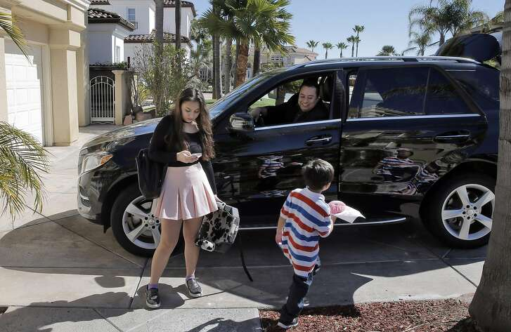 Amelia Gutierrez, 15, reads from her mobile phone as the family gets ready to leave for Sunday Mass at the family home in Discovery Bay, Calif., on Sunday, March 12, 2017. Marco Gutierrez, a 43 year old immigrant from Mexico, voted for President Trump and is the president of Latinos for President. As an outspoken Trump supporter, his politics have caused some tension at home with his 15-year-old daughter, Amelia - who was an ardent supporter of Bernie Sanders and then Hillary Clinton.