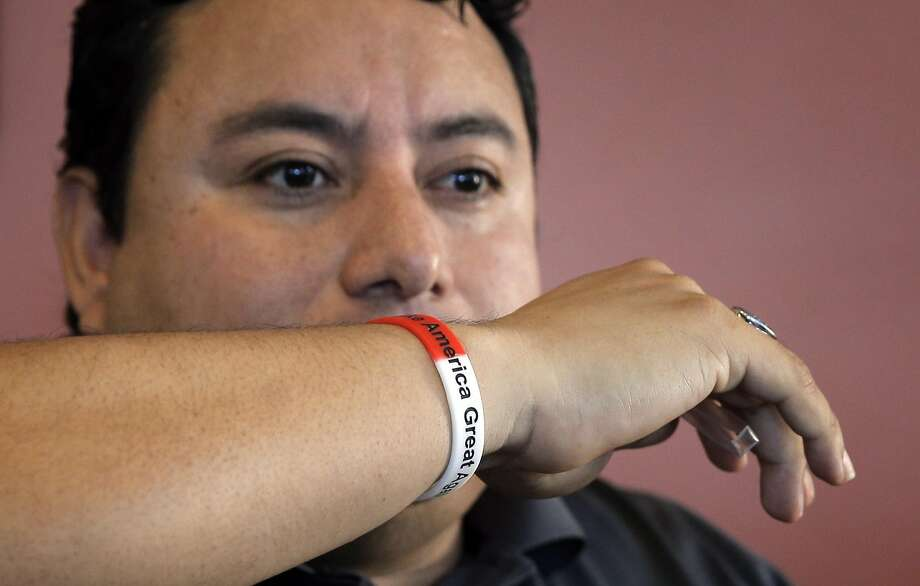 """Marco Gutierrez wears his """"Make America Great Again"""" wristband during a family lunch after Sunday Mass at Chapala Restaurant in Discovery Bay. Photo: Carlos Avila Gonzalez, The Chronicle"""
