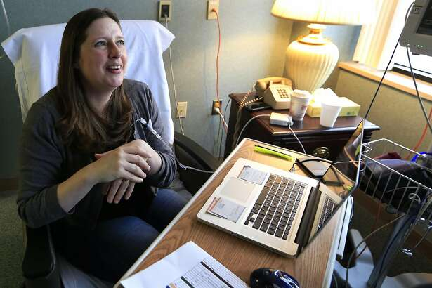 Janella Williams watches television for news on the healthcare vote while receiving treatment at Lawrence Memorial Hospital in Lawrence, Kan., Friday, March 24, 2017. The 45-year-old graphic designer receives medication from an intravenous drip for a neurological disorder, getting the drugs that she says allow her to walk. Under her Affordable Care Act plan, she pays $480 a month for coverage and has an out-of-pocket maximum of $3,500 a year. If she were to lose it, she wouldn�t be able to afford the $13,000-a-year out-of-pocket maximum under her husband�s insurance. Her treatments cost about $90,000 every seven weeks. (AP Photo/Orlin Wagner)